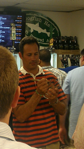 Sam Calagione signing a glass