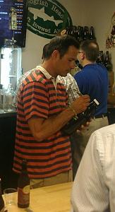Sam Calagione signing a growler