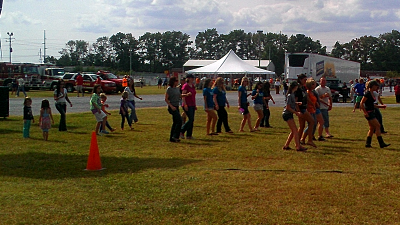 The ladies from the Cowboy Up Saloon get the crowd involved in some line dancing.
