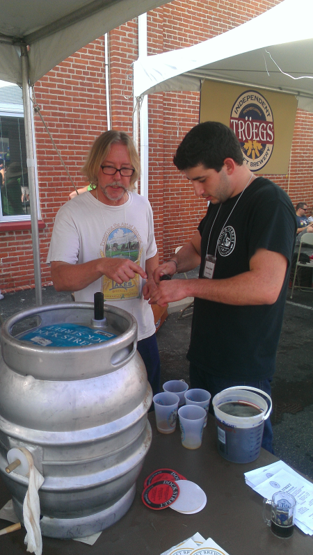 "Rob from Twin Lakes helping out at the Yards Brewing tent.  Says Rob, ""I consider these guys my sister brewery."""