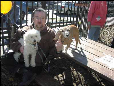 "Bill, with Ludwig and Sophie (on lap) during one of their many ""pup crawls"" (Photo: WBTHINK)"