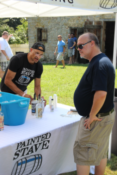 Ron (L) from Painted Stave Distillery whips up a Lemon Drop for tDoB co-founder Chuck