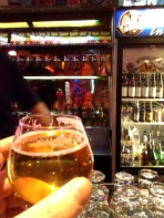 That man in the reflection is eying my beer!