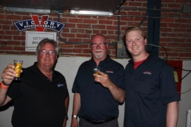 VIctory Brewing CEO Ron Barche(C) enjoying Opening Tap with his team.